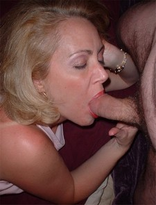 Hard sucking mature lady fondling balls and giving head