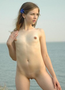 Virgin girl Anna nude in the beach