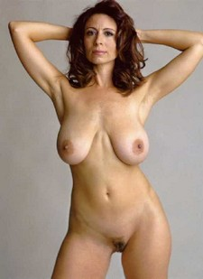 Mature brunette with large natural breasts.