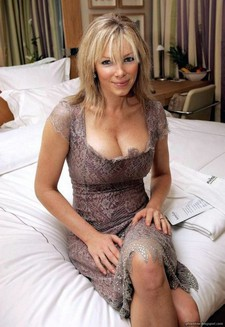Blonde cougar in bed