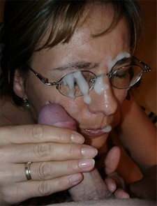 German wife getting a huge facial cumshot over her face and glasses