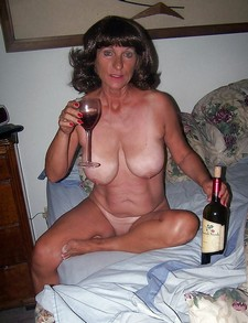 Big Titted Granny Likes A Good Glas Of Wine.