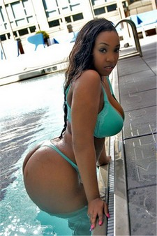 Hot bikini ebony posing with big busty boobs and great big ass in hot thong