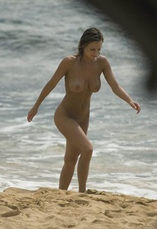 Beautiful woman with great body on the nudist beach